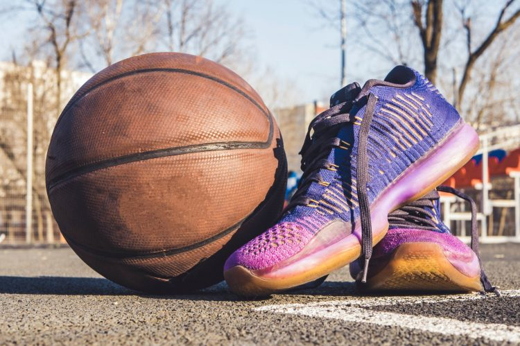 close up photography of shoes near ball